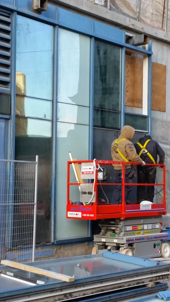 Installing exterior glazing at L Tower, January 16, 2015