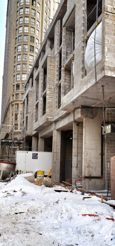 """The current Backstage """"construction streetscape"""" will be replaced by a broad sidwalk, trees, animated by retail and the entrance to the new public exhibit space on the second floor of the building."""
