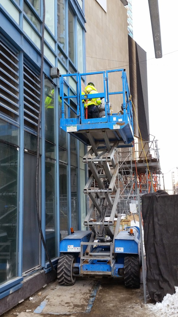 Exterior window work at the L Tower