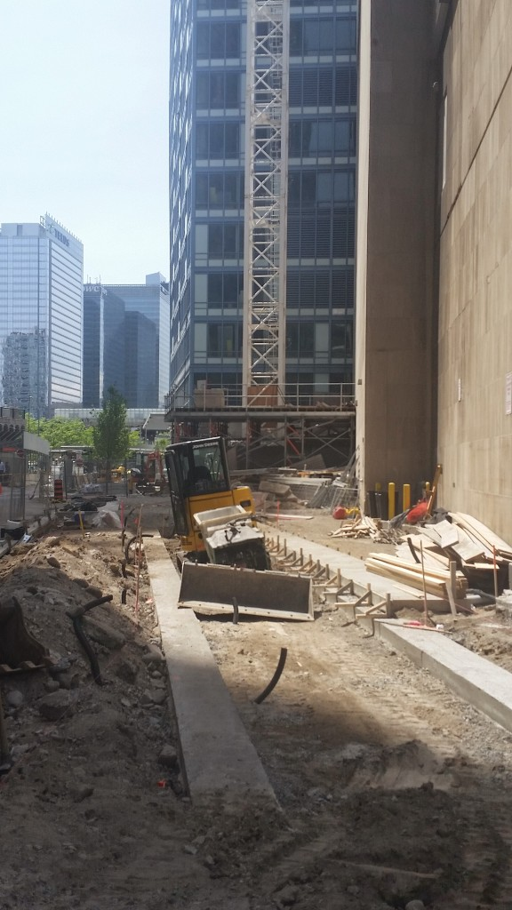 Building the new sidewalk at L Tower and Sony Centre
