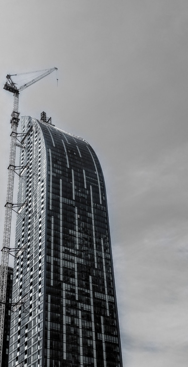 L Tower with crane and temporary window washing platform