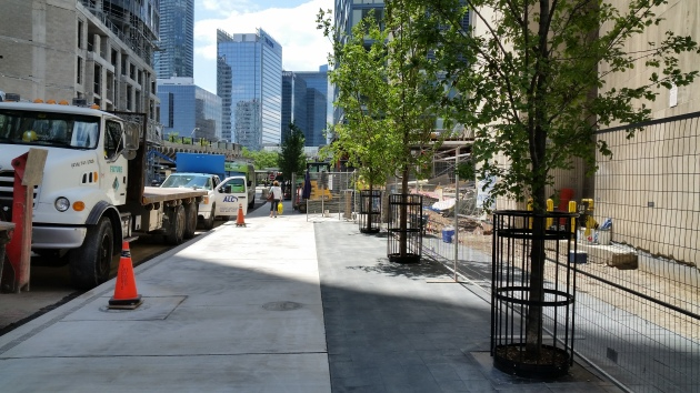 The new Esplanade sidewalk looking west to Yonge Street.