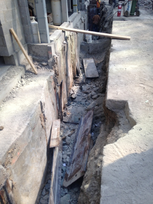Trench at Backstage to permit the removal of the remains of the construction caisson wall.