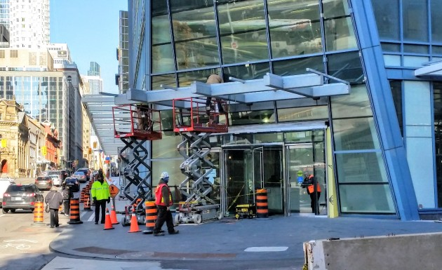 Installing the framing for the canopy glass at the L Tower