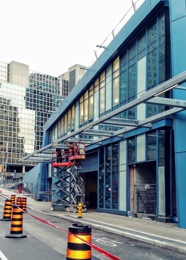 L Tower Canopy installation of lighting fixtures on November 11 along Yonge Street