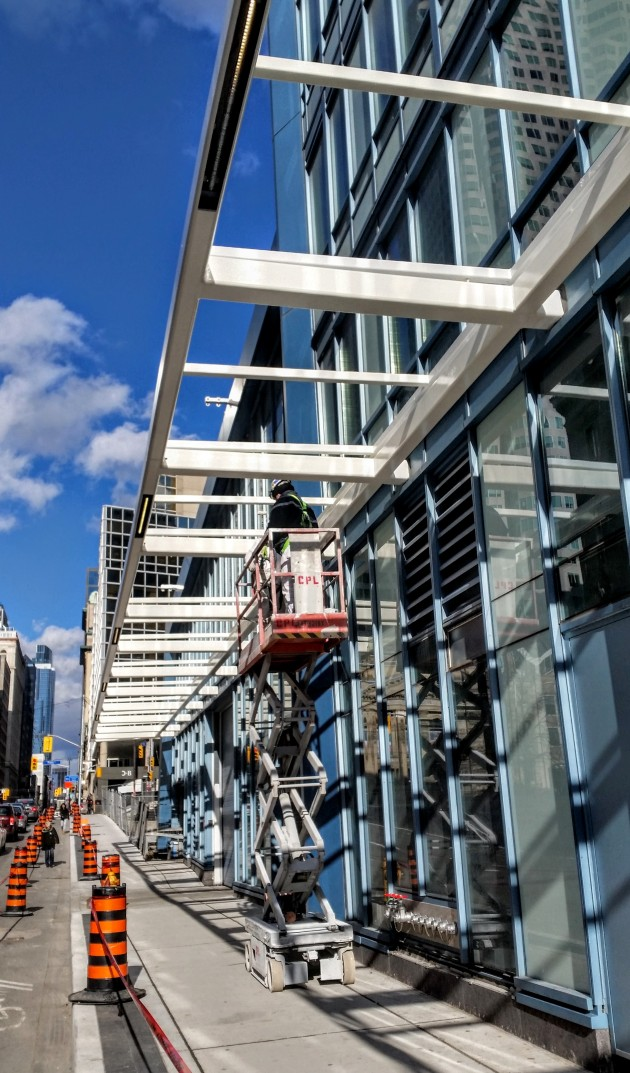 L Tower painting the canopy on Yonge Street November 20
