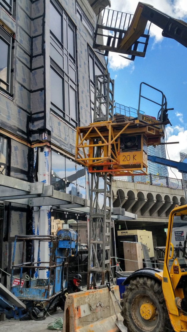 Placing the scaffolding in place required for exterior instalation and cladding work on the Backstage podium
