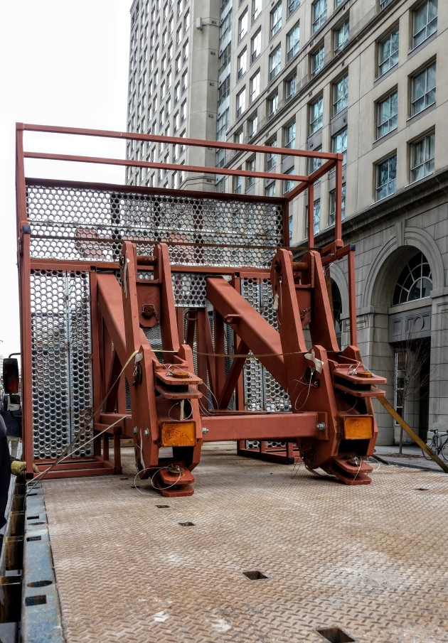 Section of the temporary derrick ready to be taken away from L Tower, December 4