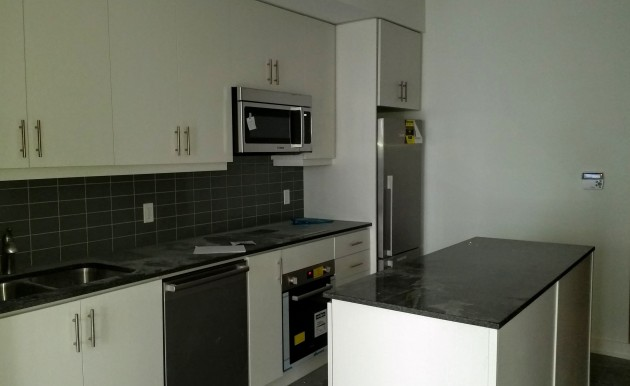 Backstage unit with kitchen appliances installed ready for cleaning.