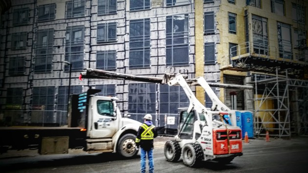 Temporary street lighting poles being loaded in at Backstage, January 15, 2016