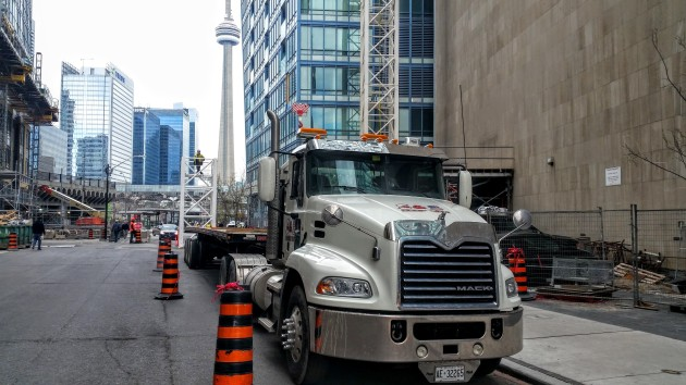 Flatbed truck on taking away a tower crane section on The Esplanade