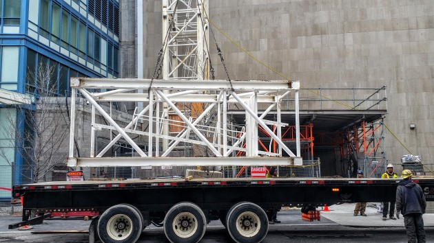 Loading a crane section onto the flatbed for removal