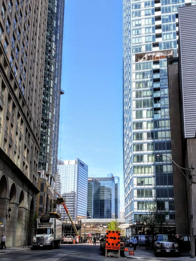 With the L Tower crane removed, remaining exterior work includes completing windows where the struts were attached and finsihing the sidewalk areas once that work is done.