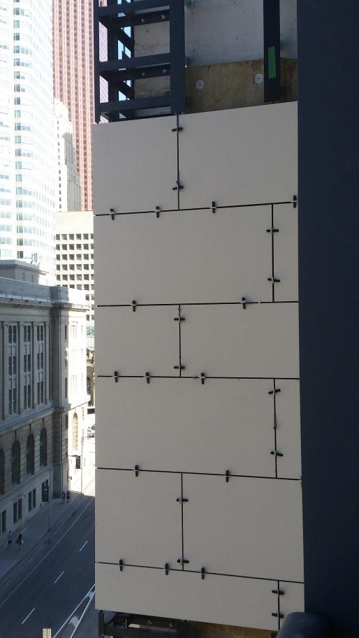 Porcelain tiles installed on the west tower fins at Backstage