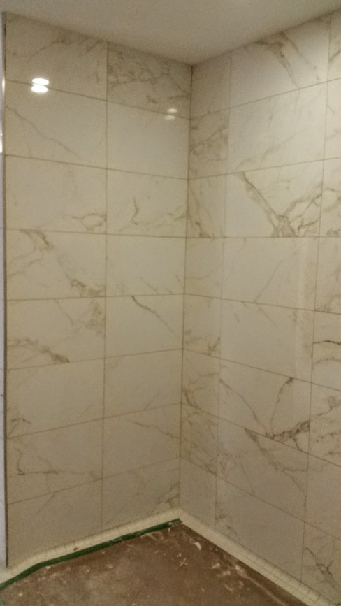 Completed tiling in amenity (gym) showers.