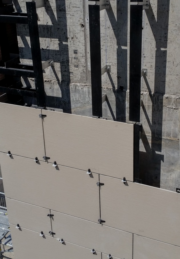 Porcelain tile installation on the west side of the tower at Backstage
