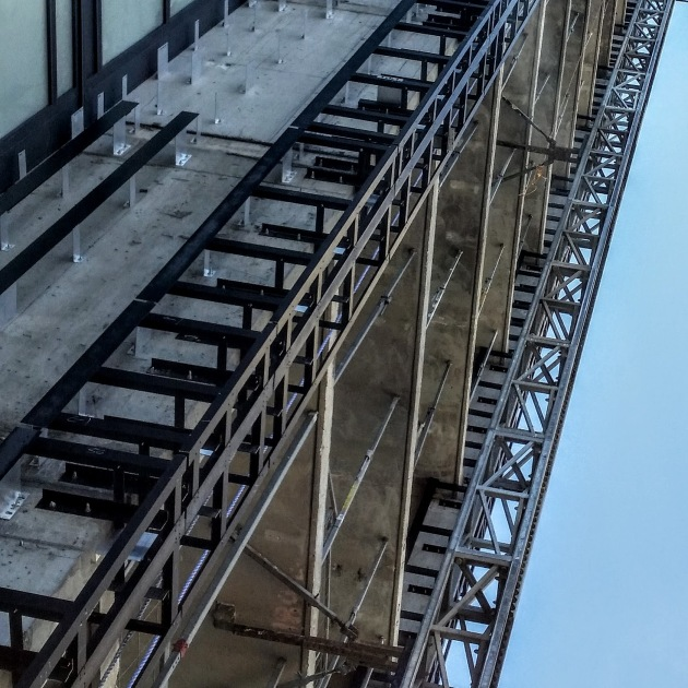 Detail of completed support brackets for the porcelain cladding on the east side of the tower at Backstage.