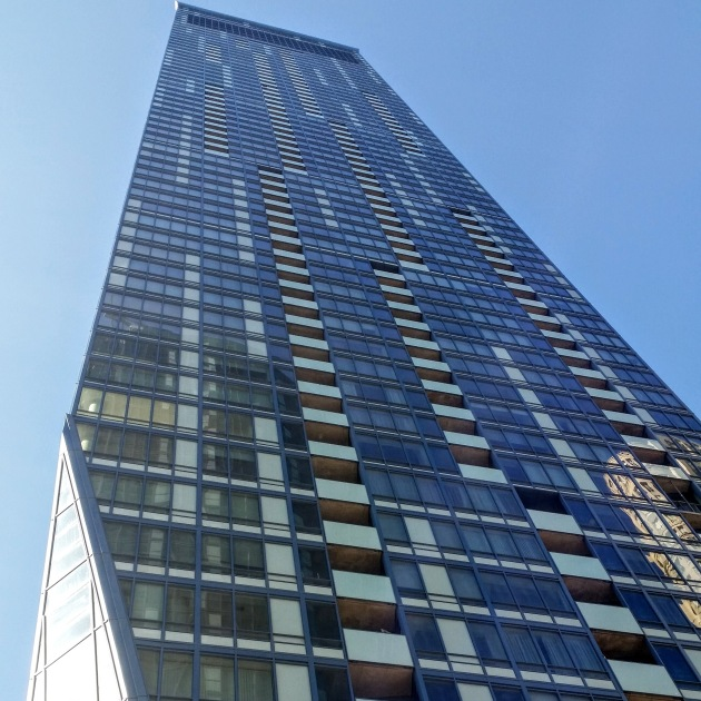 East face of the L Tower with completed windows and balconies.