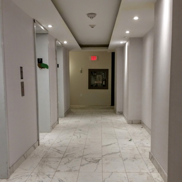 Finished floor and walls in the 7th floor elevator hallway.