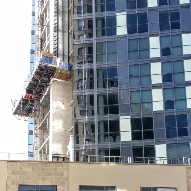 Installing porcelain tile on the east face of the tower