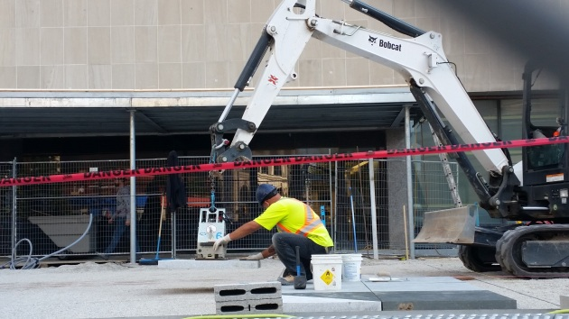 Placing paving stones on the Sony Centre northwest plaza October 7