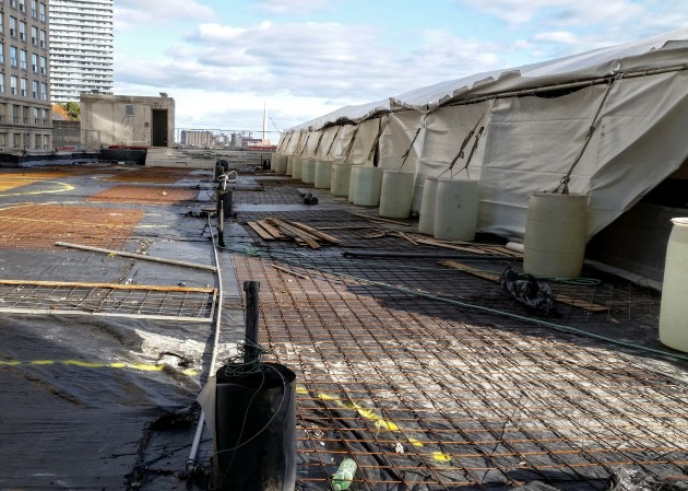 Roof deck amenity area, showing BBQ hookups and the tent enclosure to permit cold weather work on the outdoor pool.