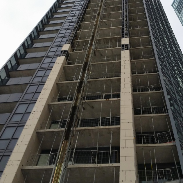 progress-continues-weather-permitting-on-installing-porcelain-cladding-on-the-east-face-of-the-tower