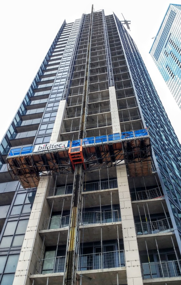 Backstage porcelain cladding installation on the east face of the tower