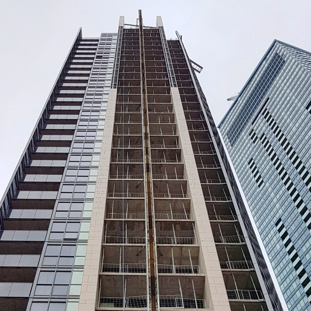 Installation of the porcelain tile on the east face of the tower reaching toward the upper floors